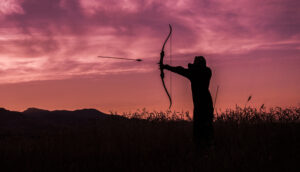 Silhouette of Hunter in Shooting with Arrow